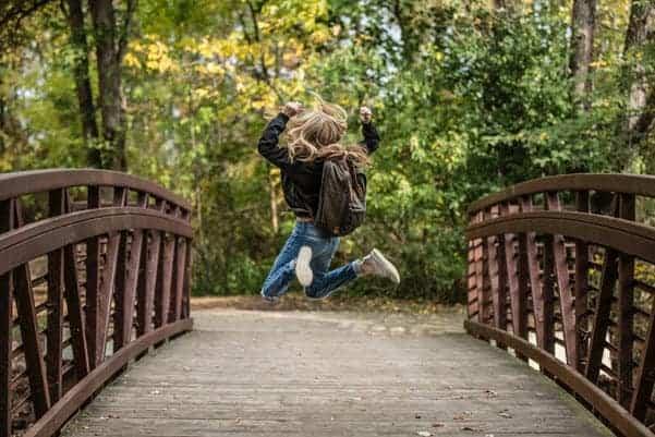 happy kid on bridge